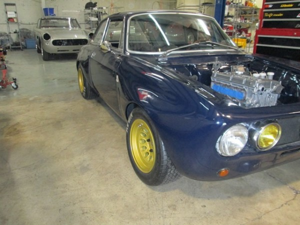 blog sports car shop part  paul is finishing up the wiring harness and finishing the assembly of the engine compartment trent is building the tunnel cover to accommodate the quaife